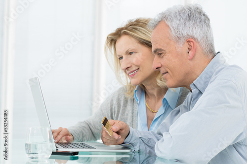 Senior Couple Shopping Online