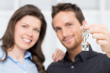 Young Couple Showing Keys Of New House