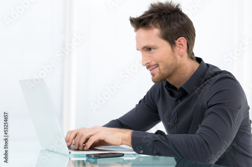 Businessman Working On Laptop