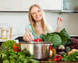 Portrait of happy blonde woman with  vegetables