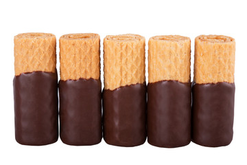 Row of chocolate waffle cookies isolated on white background