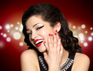 Young pretty woman with red manicure and  lips