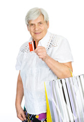 old woman with shopping bags and credit card. isolated on white