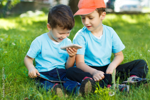 Young boys with wireless smartphone and tablet