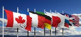 Flags of G8 members against blue sky
