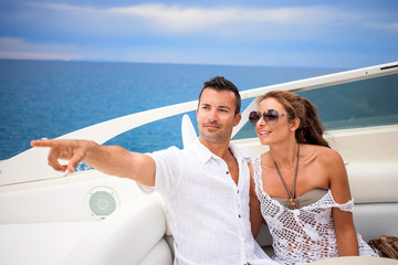 Young couple on their yacht