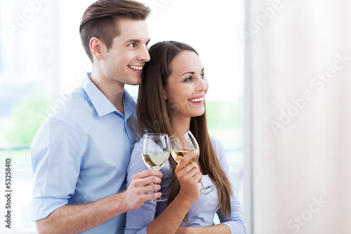 Couple drinking wine in modern apartment