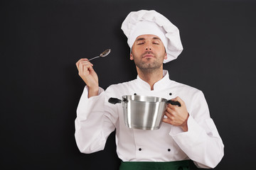 Chef enjoying the aroma of a soup