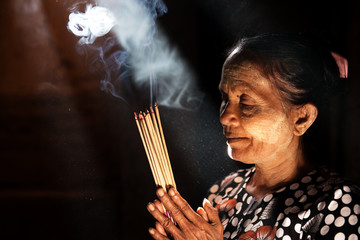 Praying with incense sticks