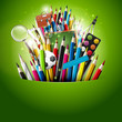 Colorful crayons and school supplies in green pocket