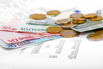 euro money coins and banknotes with payment bill