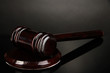 Wooden gavel on grey background