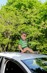 Boy on top of car
