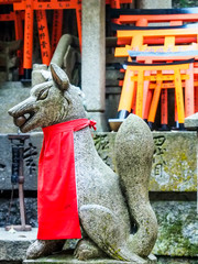fox statue at Fushimi-Inari shrine, Kyoto, Japan