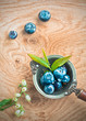 Blueberries in an old metal ladle and leafs