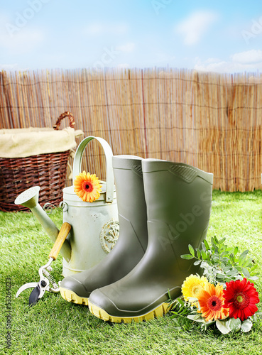 Gardener tools and equipment on a green lawn
