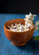 Spa. White flowers in a bowl of water on a blue vintage board