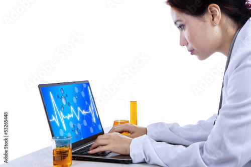 Attractive scientist with laptop on white