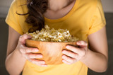 Unrecognizable woman eating popcorn at the cinema poster