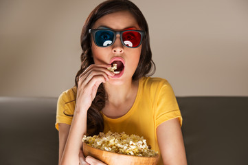 Young woman watching movie at home