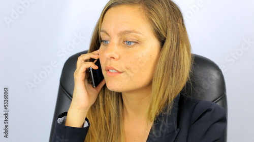 Business woman hanging up phone angry with client