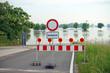 Leinwanddruck Bild - gesperrte Strasse wegen Hochwasser