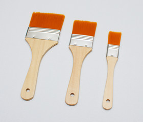 new paint brushes on canvas background