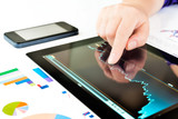 Fototapety Hand touching screen of tablet pc