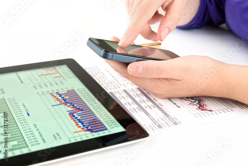 Businesswoman work with documents and tablet pc