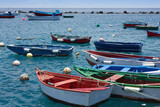 colorful fisher boats in blue turquoise sea