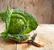 Savoy cabbage on wooden chopping board