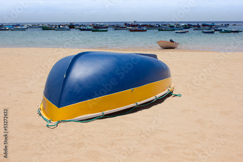 colorful fisher boats in blue turquoise sea on the beach