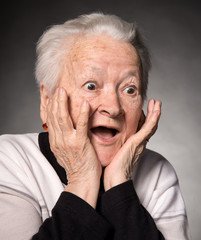 Portrait of surprised old woman
