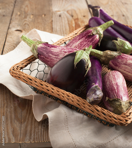 Various Eggplants on wooden table