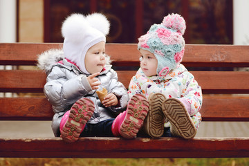 baby friends on bench
