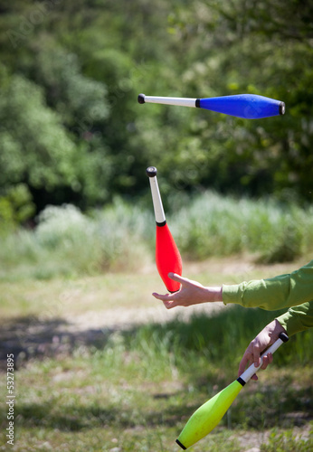throwing juggling clubs outdoor