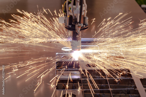 Plasma cutting process of metal with sparks