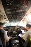 pilots preparing aircraft for take-off