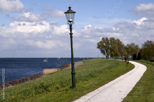 Lamppost on a dike near Medemblik in Holland