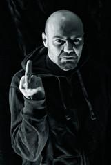 Rude man showing middle finger