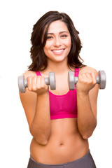 Attractive fitness woman lifting weights