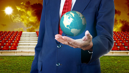 Businessman carry the virtual global with sport arena background