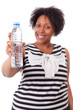 Overweight young black woman holding an water bottle - African p