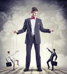 Businessman puppeteer
