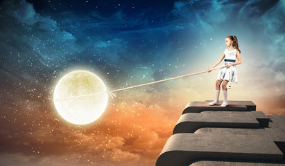 Little girl pulling moon