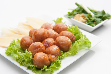 Thai traditional sausages served on white dish