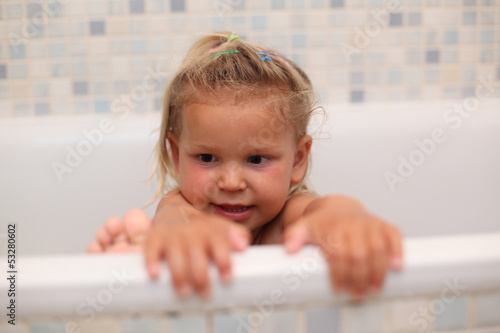 Little girl playing in the bath tub
