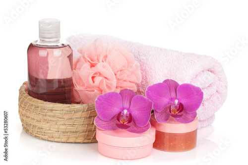 Cosmetics, towel and orchid flowers