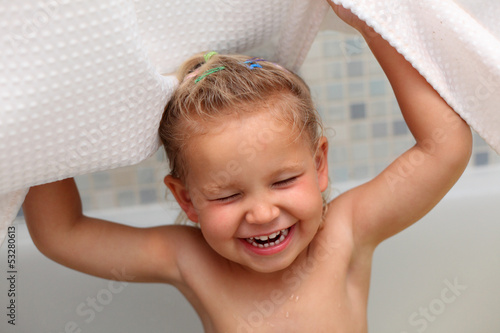Little girl having fun in the bath tub