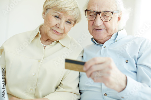 Senior couple with card